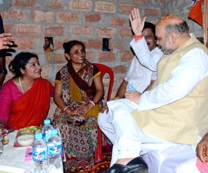 Amit Shah visits party workers residence