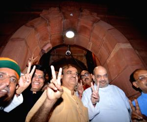 BJP chief Amit Shah with Union Ministers Piyush Goyal, Ananth Kumar and Arjun Ram Meghwal come out of Parliament after no-confidence motion against Modi government was defeated on July 21, ...