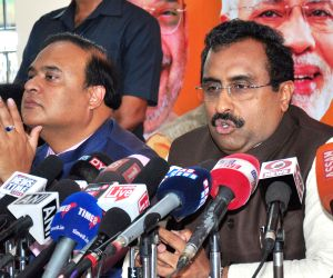 BJP General Secretary Ram Madhav accompanied by Assam Finance Minister and party leader Himanta Biswa Sarma addresses a press conference in Guwahati, on March 24, 2019.