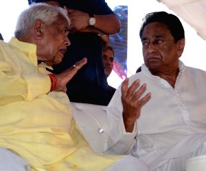 BJP leader Babulal Gaur in a conversation with Madhya Pradesh Congress chief Kamal Nath during a programme, in Bhopal on June 10, 2018.