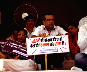BJP leader Paresh Rawal observes a day-long fast to protest the disruption of Parliament's budget session by opposition parties; in Mumbai on April 12, 2018.
