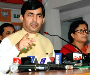 Syed Shahnawaz Hussain addresses press