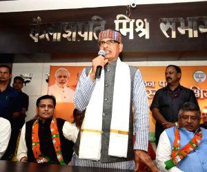 BJP leaders Shivraj Singh Chouhan addresses at the launch of BJP Membership drive, in Patna on July 20, 2019. Also seen Union Minister Ravi Shankar Prasad and BJP leaders Rajiv Pratap Rudy and ...