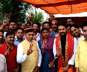 BJP Lok Sabha candidate, Anurag Thakur accompanied by his father-former Himachal Pradesh Chief Minister Prem Kumar Dhumal, celebrates after he emerged victorious from the Hamirpur Lok Sabha ...