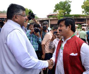 BJP MP Ravi Kishan with Union Law Minister Ravi Shankar Prasad at Parliament in New Delhi on July 17, 2019.