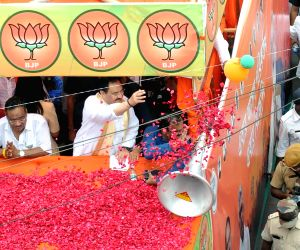 BJP National President, JP Nadda at a road show in support of Rajarhat Gopalpur BJP candidate Samik Bhattacharya during election campaign for State Assembly election in Kolkata, on April 9, 2021.