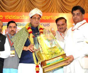 BJP president Rajanath Singh with party president for Karnataka Prahalad Joshi and Anant Kumar during a party meeting