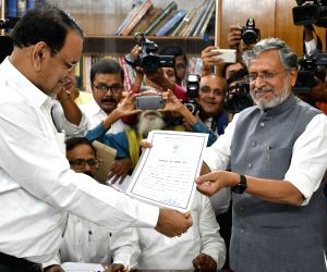 BJP's newly elected MLC Sushil Kumar Modi receives his election certificate, in Patna on April 19, 2018.