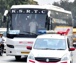 BMTC and KSRTC buses resumes service for public in police security during the BMTC and KSRTC bus workers indefinite strike to protest against the government's failure to implement a salary under the 6th Pay Commission for the RTC workers, in Bengaluru on Friday 9th April 2021.