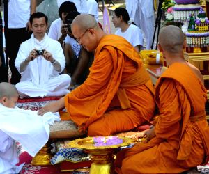 Buddhist nuns participate in a religious programme