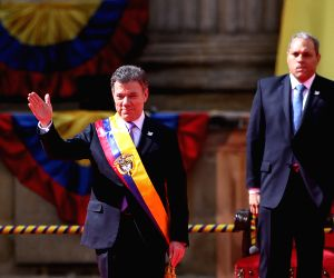 Colombian President Juan Manuel Santos attends the swearing-in ceremony in Bogota