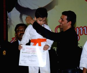 Bollywood Actor Akshay Kumar addresses during 1st Invitational Open National Karate Championship at Andheri Sports Complex, Mumbai on Wednesday, 21 October 2009.