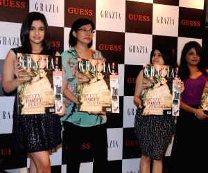 Alia Bhatt poses during the launch of Grazia magazine party