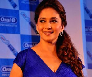 Bollywood actress Madhuri Dixit during the launch of Oral-B Pro Health toothpaste in Mumbai on 2 July 2013