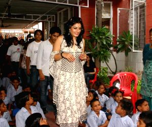 Bollywood actress Raveena Tandon at the school ''Nai Disha'' in New Delhi on Saturday, at a programme to celebrate channel ''Colours''  frist anniversary.