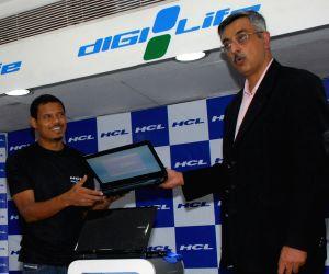 Brazlian player Jose Ramirez Barreto and Gorge Paul executive vice President - Marketing, HCL Infosystems ltd at  lunching pogram of HCL's powerful laptop in Kolkata on wednesday 29Apr 09.