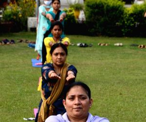 BSF personnel perform Yoga on the occasion of International Day of Yoga on the outskirts in Amritsar.