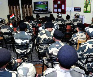 BSF personnel watch India Vs Pakistan match