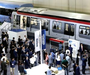 Busan: Visitors look at Hyundai Rotem-made trains for the Hong Kong subway at the 2017 RailLog Korea, one of the world's four largest rail industry expos, which opened for a four-day run at an exhibition center in Busan on June 14, 2017, participated