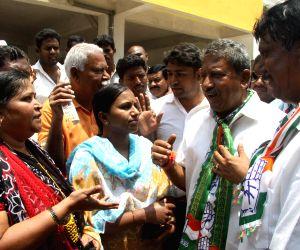 Congress Candidate Byrathi Basavaraju campaigning
