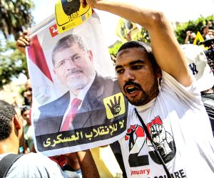 Supporters of Egypt's ousted President Mohammed Morsi shout slogans during a march