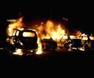 Two groups clash, cars torched
