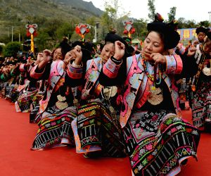 People of Qiang ethnic group play musical instrument to celebrate their new year