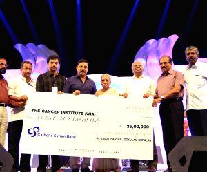 Kamal Haasan contributes on behalf of All India Malayalee Association