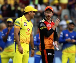 Chennai Super Kings captain MS Dhoni and Sunrisers Hyderabad captain Kane Williamson during the toss ahead of IPL 2018 final match between Chennai Super Kings and Sunrisers Hyderabad, at ...