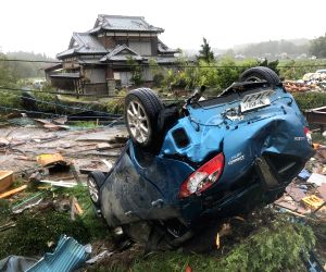 CHIBA, Oct. 12, 2019 (Xinhua) -- A car is overturned after a tornado hit Chiba Prefecture near Tokyo, Japan, on Oct. 12, 2019. A tornado formed during the course of the Typhoon Hagibis hit Chiba Prefecture near Tokyo on Saturday, injuring five people