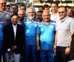 Chief Justice of India (CJI) Dipak Misra, former Indian cricketer Virender Sehwag and other dignitaries at an annual cricket match between Chief Justice of India-XI and Supreme Court Bar ...