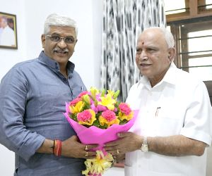 Chief Minister of Karnataka BS Yediyurappa being greeted by Union Water Resources Minister Gajendra Singh Shekhawat on the occasion of his 78th birthday celebrations , in Bengaluru on Saturday 27th February 2021