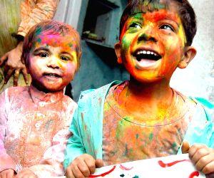 Children at the eve of Holi on New Delhi, 28 Feb 2010.