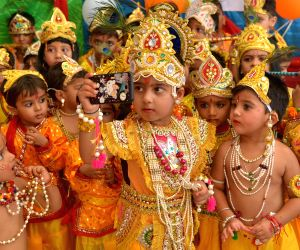 children-dressed-up-as-lord-krishna-pose-for-a