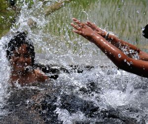 Children play with water