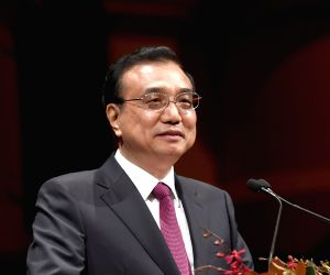 China won't devalue yuan, says PM Li