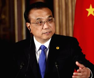 Chinese Premier Li Keqiang speaks during a joint press conference with South Korean President Moon Jae-in and Japanese Prime Minister Shinzo Abe as they issue a special statement after holding ...