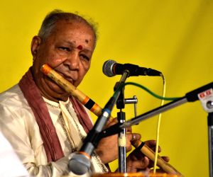 Pandit Hariprasad Chaurasia performs during a programme