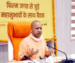 UP CM Yogi covets biz, Bollywood and big bucks from Mumbai