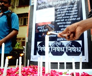 College students protest against the rape and murder  of a girl