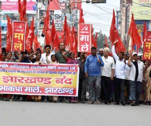 Communist Party of India-Marxist Leninist (CPI-ML) workers stage a demonstration during a shutdown called by the opposition parties to protest against an amendment in the Land Acquisition Act ...
