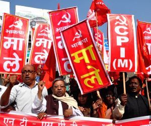 Communist Party of India (Marxist Leninist) workers stage a demonstration during a Jharkhand Bandh called by all opposition parties to protest against Jharkhand Government's Chotanagpur ...