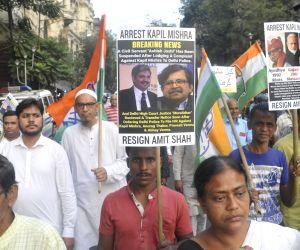 Congress activists protest against Amit Shah