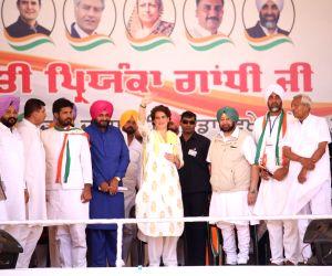 Congress General Secretary (Uttar Pradesh East) Priyanka Gandhi Vadra accompanied by Punjab Chief Minister Captain Amarinder Singh and state cabinet minister Navjot Singh Sidhu, waves at ...
