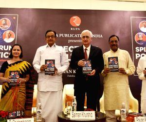 Congress leader and author Salman Khurshid with the book's co-author Daksha Sharma, Congress MP P. Chidambaram, journalist Rajdeep Sardesai, JD-U leader Pavan Varma and Former TRAI ...