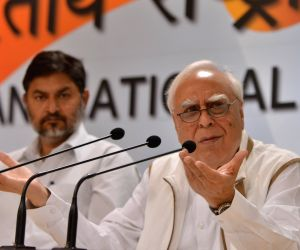 Congress leader Kapil Sibal addresses a press conference in New Delhi, on March 30, 2018.