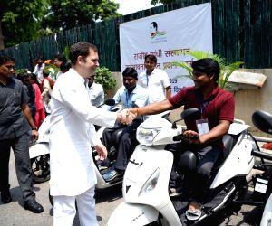 Congress distributes scooters on Rajiv Gandhi's 75th birth anniversary