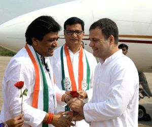 Congress leader Rahul Gandhi welcomed by Maharashtra Congress President Balasaheb Thorat and party leader Ashok Chavan, as he arrives on his maiden campaign tour for Maharashtra in Latur, on ...