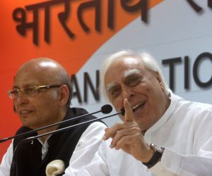 Congress leaders Abhishek Manu Singhvi and Kapil Sibal address a press conference, at the party office in New Delhi on May 19, 2018.