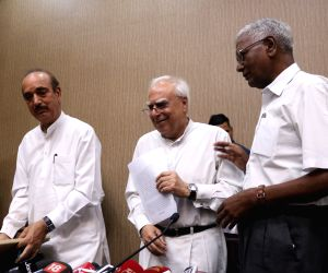 Congress leaders Ghulam Nabi Azad, Kapil Sibal and CPI leader D Raja during a press conference regarding Impeachment motion of Chief Justice of India, in New Delhi on April 20, 2018.